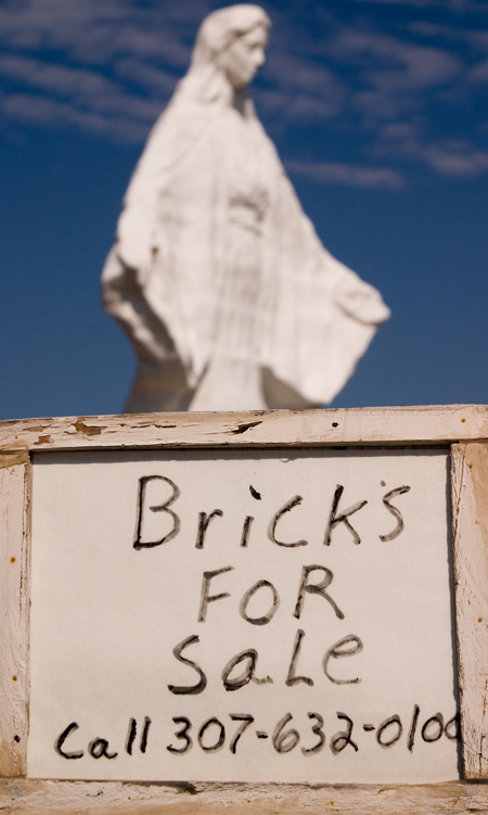 Advertisement near the Virgin Mary statue, Pine Bluffs, WY. Seth Rosenblatt (c) 2006