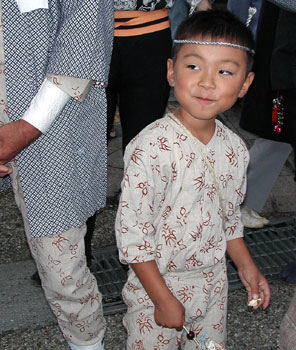 A young boy at the mikoshi matsuri.