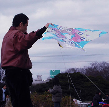 Man flying a kite, Komazawa Park.